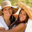 Mother and daughter hugging outdoors summer teen — Stock Photo