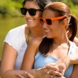 Stock Photo: Mother and daughter relaxing in park smiling