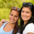 Mother and daughter smiling in the park — Stock Photo #13248671