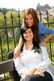 Mother and daughter in the park smiling — Stock Photo
