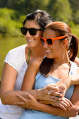 Mother and daughter relaxing in park smiling — Stock Photo