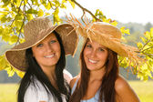 Mother and teen daughter relaxing outdoors happy — Stock Photo