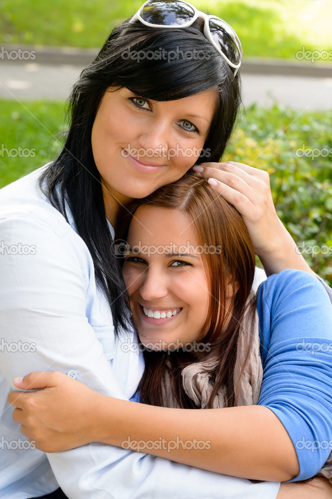 Mother holding teen daughter in her arms happy bonding park — Stock Photo #13248520