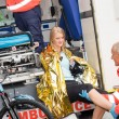 Stock Photo: Paramedics with woman bike accident in ambulance