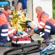 Accident bike woman get emergency help paramedics — Stock Photo