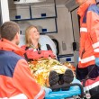 Emergency doctor with woman in ambulance — Stock Photo #13598023