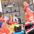 Emergency doctor with woman in ambulance — Stock Photo #13598025