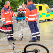 Stock Photo: Paramedics with womon stretcher ambulance aid