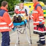 Injured woman talking with paramedics emergency — Stock Photo