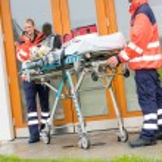 Emergency doctor home visit call radio ambulance — Stock Photo