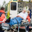 Oxygen mask patient treatment ambulance stretcher - Foto de Stock