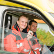 Emergency paramedic in ambulance car talk radio — Stok fotoğraf