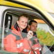 Emergency paramedic in ambulance car talk radio - Foto de Stock