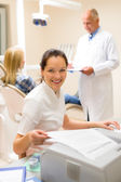 Dental assistant prepare patient personal document — Stock Photo