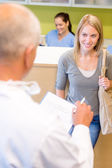 Dentist calling next patient for dental checkup — Stock Photo