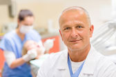 Mature dentist surgeon at office portrait — Stock Photo