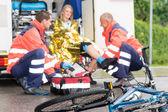 Accident bike woman get emergency help paramedics — Stock Photo