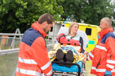Injured woman talking with paramedics emergency — Stock Photo