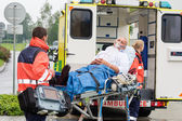 Oxygen mask patient treatment ambulance stretcher — Stock Photo
