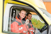 Emergency paramedic in ambulance car talk radio — Stock Photo