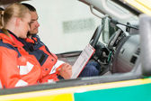 Emergency ambulance car paramedics sitting work — Stock Photo