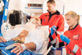 Sick patient with paramedic in ambulance treatment — Stok fotoğraf