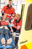 Paramedics help unconscious woman emergency aid — Stock Photo