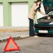 Car breakdown womcalling for road assistance — Stock Photo #13603843