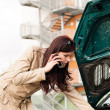Womlooking under car hood on phone — Stock Photo #13603884