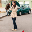 Upset woman on the phone car problem — Stock Photo