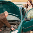 Car breakdown woman calling for road assistance - Stock Photo