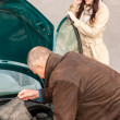 Woman on the phone having car problems — Stock Photo #13603925