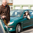 Man helping woman with her broken car — Stock Photo #13603963