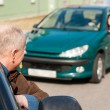 Man pulling a woman's car with problems — Stock Photo