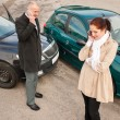 Stock Photo: Womand mon phone car crash