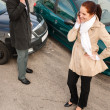 Stock Photo: Woman and man on phone car crash