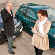 Woman and man on phone car crash — Stock Photo #13603990