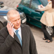 Man on the phone after colliding car — Stock Photo