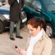 Woman calling insurance after car accident crash — Stock Photo