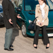 Man and woman talking after car crash - Stock Photo