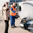 Foto de Stock  : Car breakdown womget help road-assistance man