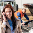 Woman talking on cellphone after car breakdown — Stock Photo #13604011