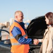 Royalty-Free Stock Photo: Woman greeting mechanic after her car breakdown