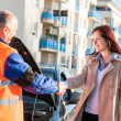 Stock Photo: Womgreeting mechanic after her car breakdown