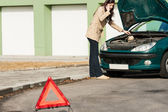 Car breakdown woman calling for road assistance — Stock Photo