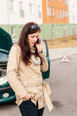 Woman on the phone for car help — Stock Photo