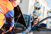Car troubles woman starting broken vehicle — Stock Photo