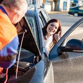 Mechanic fixing car happy woman thumb up — Stock Photo