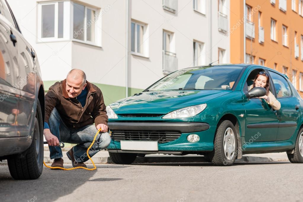 Mature man helping woman with her car breakdown broken problem — Stock Photo #13603971