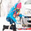 Winter car tire snow chains woman — Stock Photo